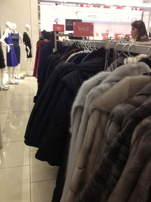 The fur coat sale section was buzzing with shoppers
