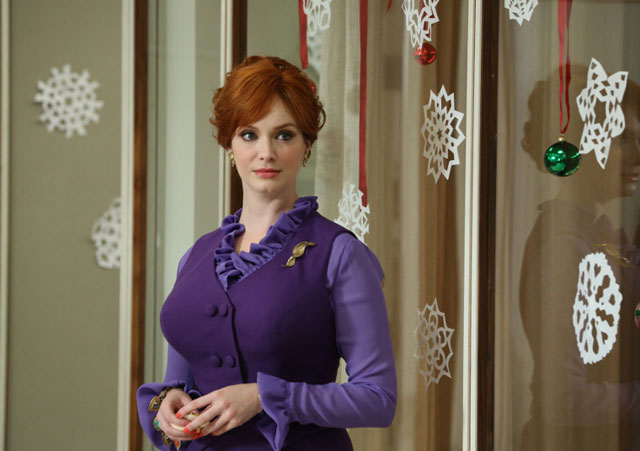 Picture Perfect Joan in a form-fitting, frilly purple frock on the Mad Men Season 6 Premiere