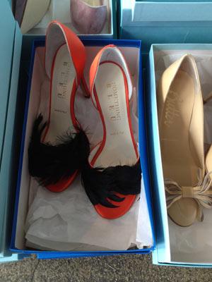 Something Bleu's eye catching Carnation and Black Feather Heels ($100)