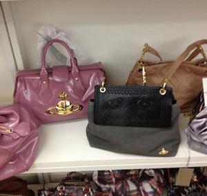 Vivienne Westwood Medium Nero Clutch Crossbody Bag ($290), Squiggle Leather Bag in Rose ($358)