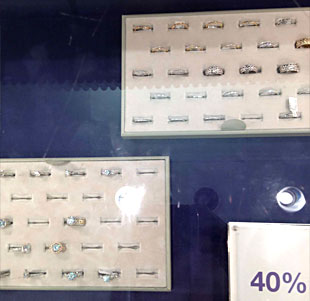 Michael C. Fina 30% off display featured platinum, white gold, and rose gold engagement rings and wedding bands