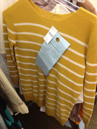 Yellow and White Stripped Cashmere Sweater by The Row with a small hole on its left shoulder ($389)