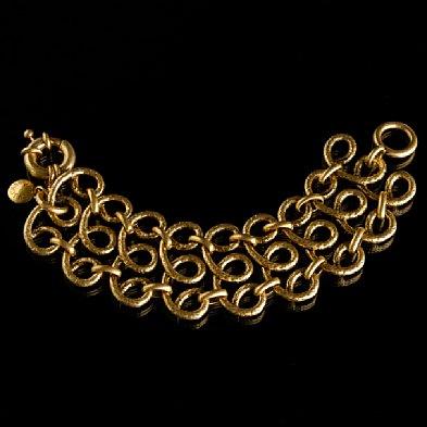 jcrew gold scroll bracelet vogue city